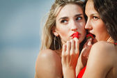 Two sexy girls with strawberries — Stock Photo