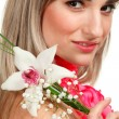 beautiful blond girl with orchid flower isolated on white backgr — Stock Photo