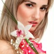Beautiful blond girl with orchid flower isolated on white backgr — Stock Photo #6428758