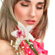 Beautiful blond girl with orchid flower isolated on white backgr — Stock Photo #6428762