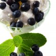 Stock Photo: Ice cream with blueberries and mint.