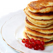Pancakes with red currants. — Stock Photo