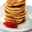 Stock Photo: Pancakes with red currants.