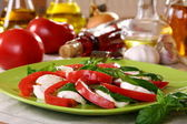 Salad caprese with fresh tomatoes, cheese and basil. — Stock Photo