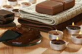 Sensuality spa chocolate aromatherapy items. — Stock Photo