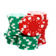 Poker chips stacked on a white background. - Stock Photo