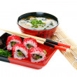 Stock Photo: Japanese Cuisine - rolls and miso soup on white background.