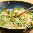 Stock Photo: Rice noodles in spicy souche.