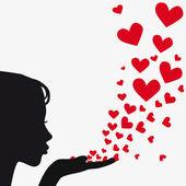 Silueta ženy foukání srdce — Stock vektor