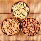 Nuts in bowls — Stock Photo
