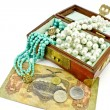 Wooden treasure chest with jewelry and money — Stock Photo #5407458