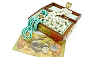 Wooden treasure chest with jewelry and money — Stock Photo