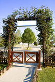 Green floral arch gate — Stock Photo