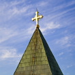 Golden cross on a blue sky — Stock Photo #5677135