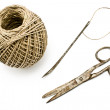 Old rusty scissors and needle with clew- sewing tools - Stock Photo