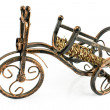 Rustic wine rack in form of tricycle - Stock Photo
