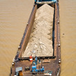 Riverboat barge with sand on green river — Stock Photo #5837994