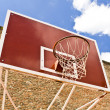 Red basketball board over brick wall and blue sky — Stock Photo
