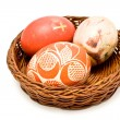 Painted easter eggs in brown basket — Stock Photo