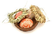 Painted easter eggs with straw wreaths — Stock Photo