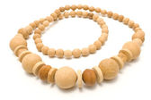 Necklace made of yellow wooden balls — Stock Photo