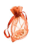 Red gift sack with pearls — Stock Photo