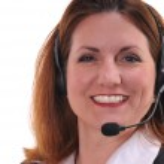 Pretty woman wearing headset — Stock Photo