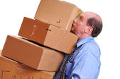 Man carrying heavy boxes. — Stock Photo