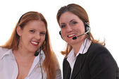 Two business women with headsets — Stock Photo