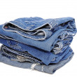 Blue Jeans folded in a neat stack — Stock Photo