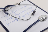 Stethoscope and cardiogram — Stock Photo