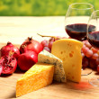 Stock Photo: Cheese and two goblets blame close-up