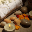 图库照片: Sptreatment stone,candles towel close-up