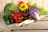 Fresh vegetables with vegetable garden on table — Stock Photo