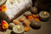 Spa treatment stone,candles towel close-up — Foto Stock