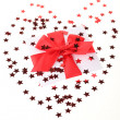 Red bow and much stars — Stock Photo