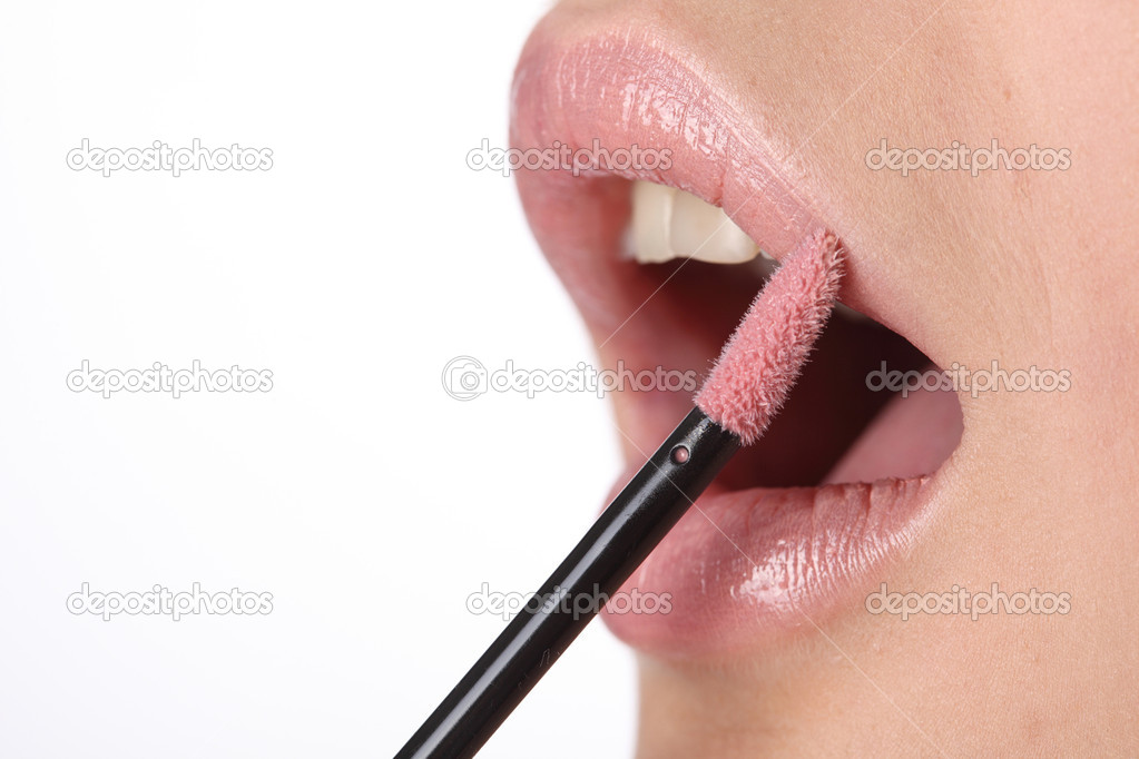 Making look younger girl dyes lips — Stock Photo #5809868