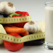 Milk,vegetables and measuring tape - Stock Photo