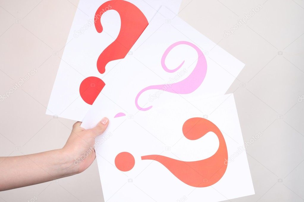 Interrogative signs in hand beside girls — Stock Photo #5810240