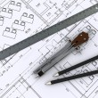 Compass, ruler and pencil on architectural drawings — Stock Photo