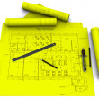 Compass, ruler and pencil on yellow architectural drawings — Stock Photo