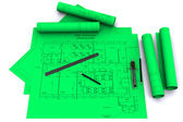 Compass, ruler and pencil on green architectural drawings — Stock Photo