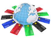 Multicolored bank cards around the Earth — Stock Photo