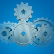 The gear wheels on a blue background — Stock Photo