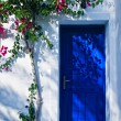 Blue door in greece — Stock Photo