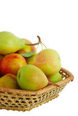 Cropped closeup of fresh fruits in interwoven basket — Stock Photo