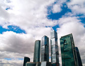 Skyscrapers tops on sky with cloud — Stock Photo