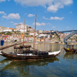 Old Porto and traditional boats with wine barrels — Stock Photo #5670265