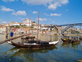 Old Porto and traditional boats with wine barrels — Stock Photo