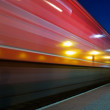 Red speeding night train blur — Stock Photo